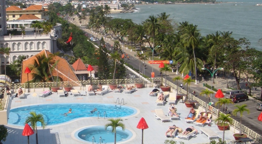 A view of the hotel swimming pool and Nha Trang City from above